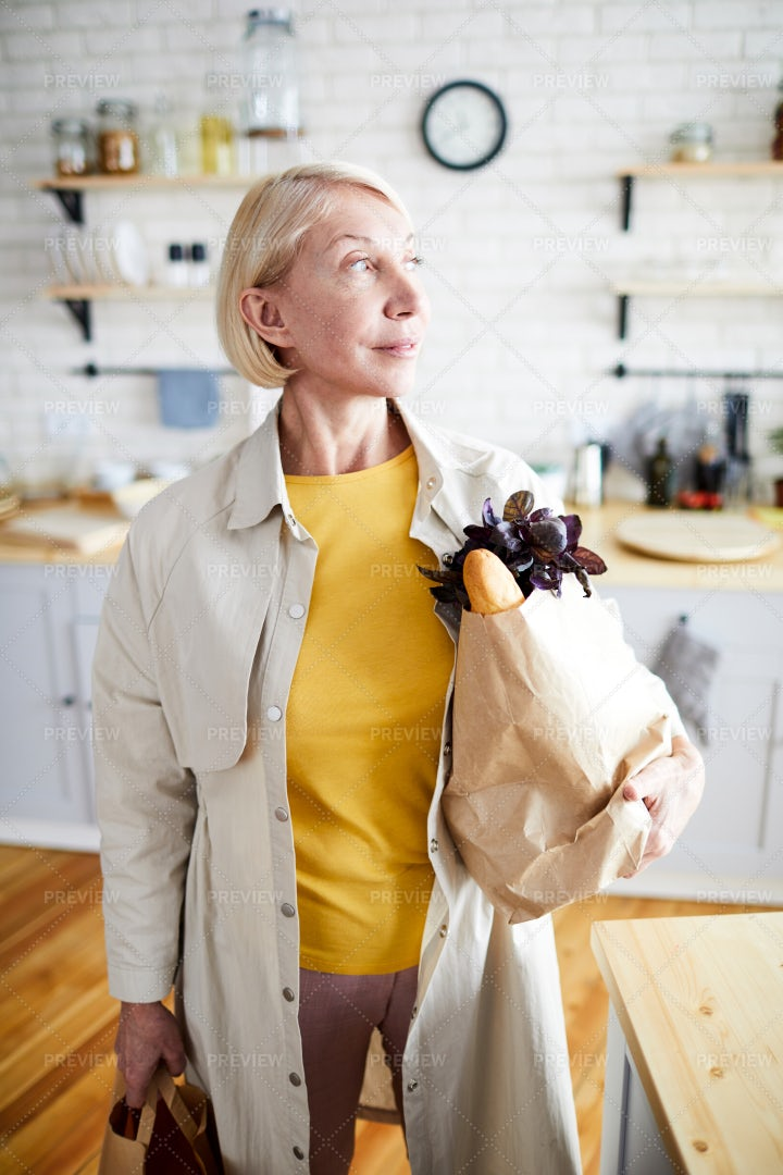 Lady With Full Bags In Kitchen: Stock Photos