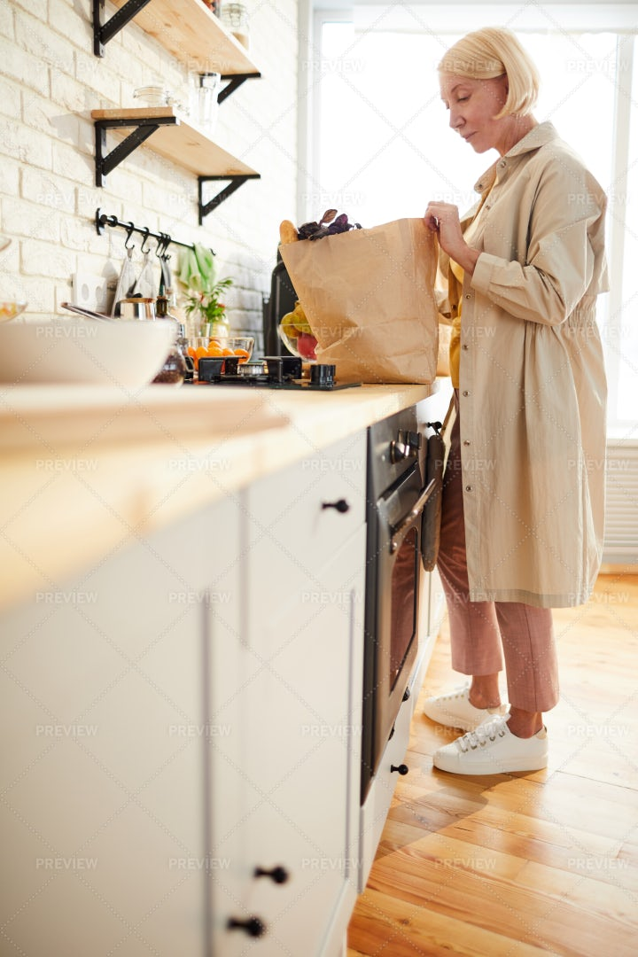 Blond Woman After Shopping In...: Stock Photos