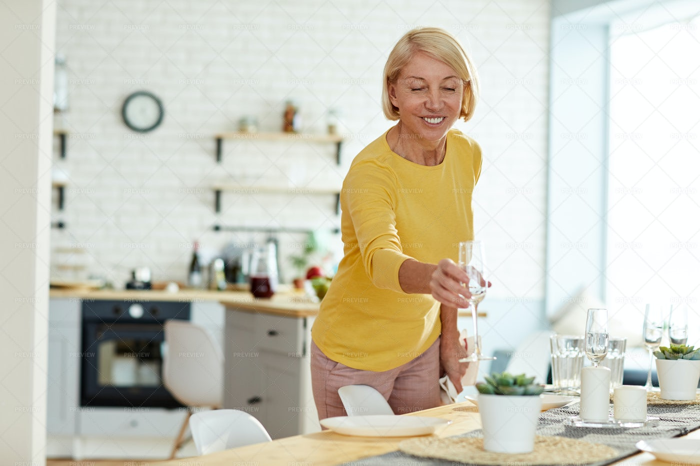 Smiling Woman Putting Flute On...: Stock Photos