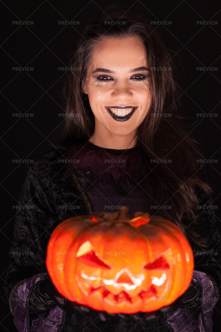 Woman Wearing A Witch Outfit: Stock Photos