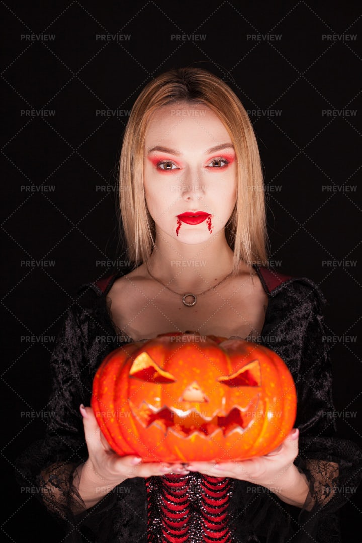 Vampire Holding A Pumpkin: Stock Photos