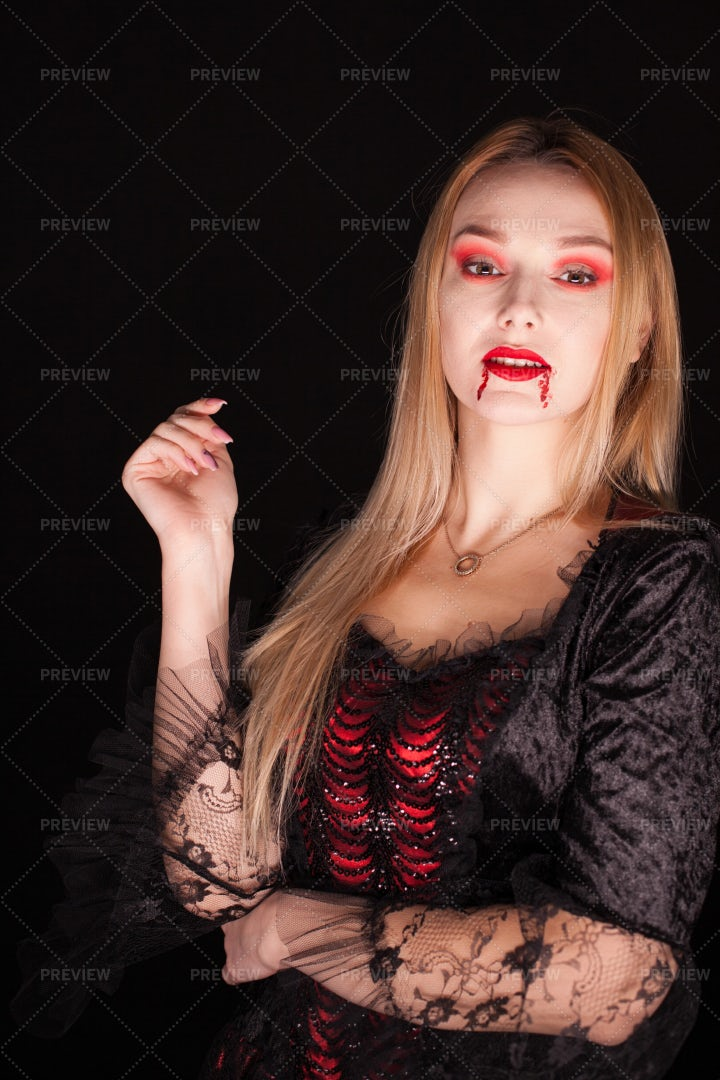 Vampire With Bloody Lips: Stock Photos