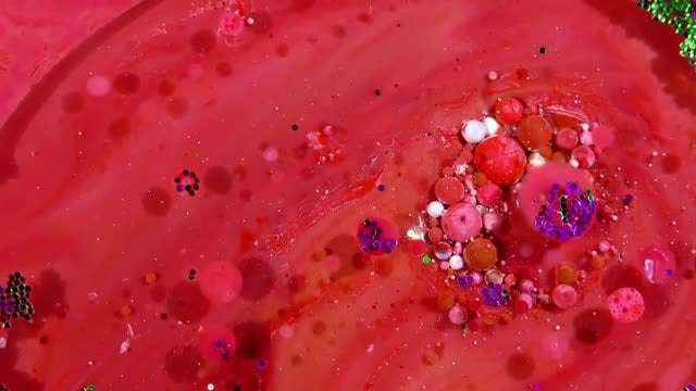 Colorful Ink Spheres On Oil 13: Stock Video