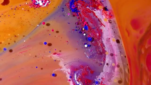 Colorful Ink Spheres On Oil 16: Stock Video