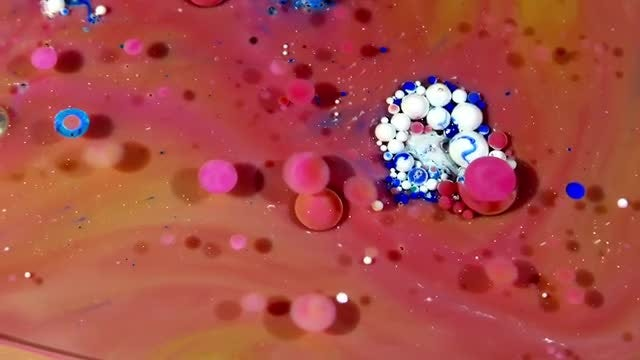 Colorful Ink Spheres On Oil 20: Stock Video