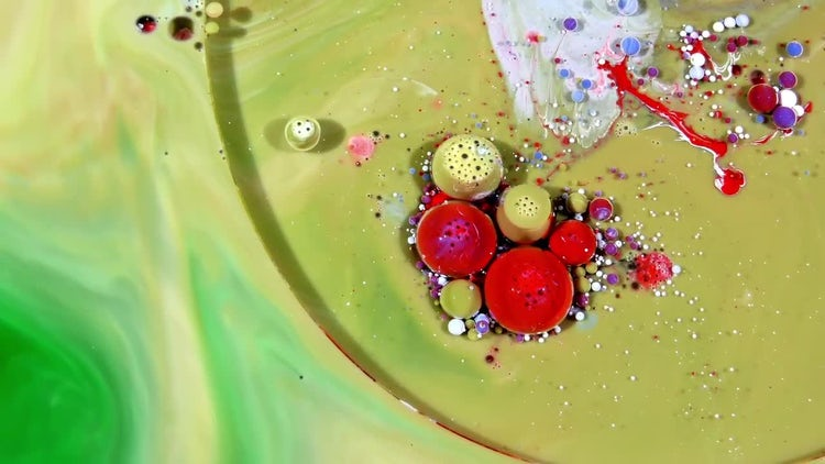Colorful Ink Spheres On Oil 22: Stock Video