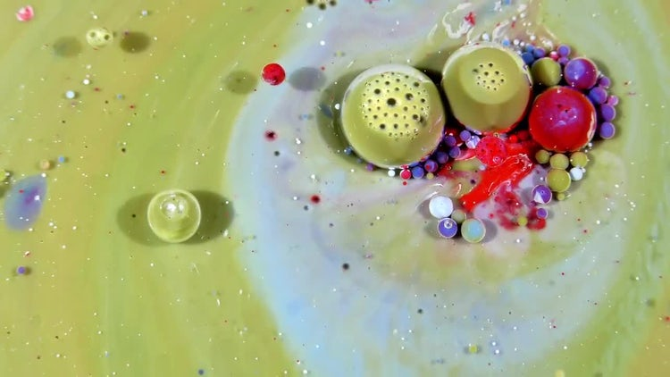 Colorful Ink Spheres On Oil 23: Stock Video