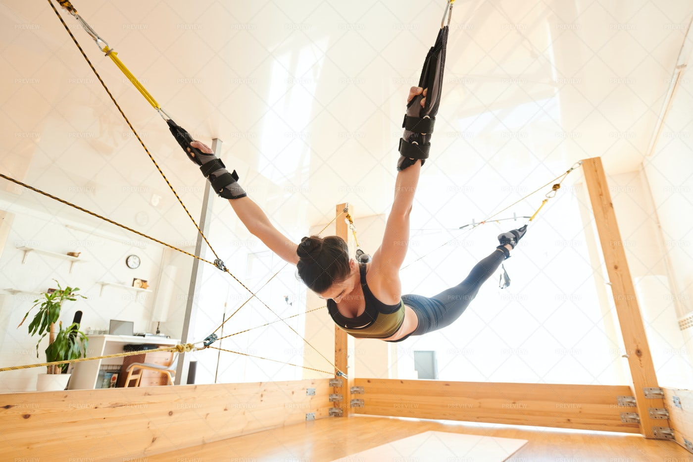 Anti-gravity Yoga Exercise: Stock Photos