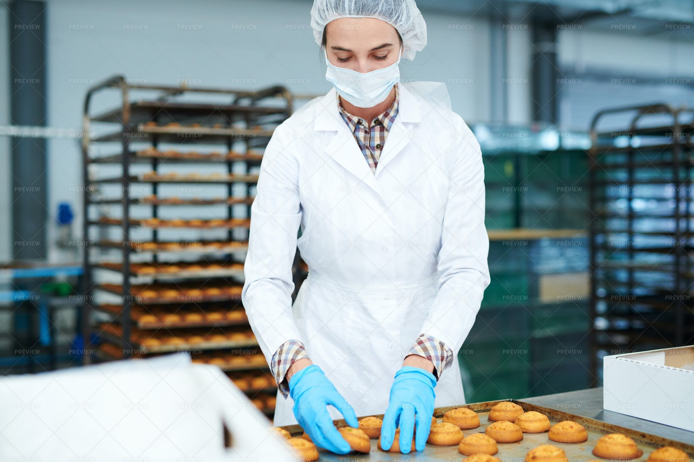 Confectioner Collecting Freshly...: Stock Photos