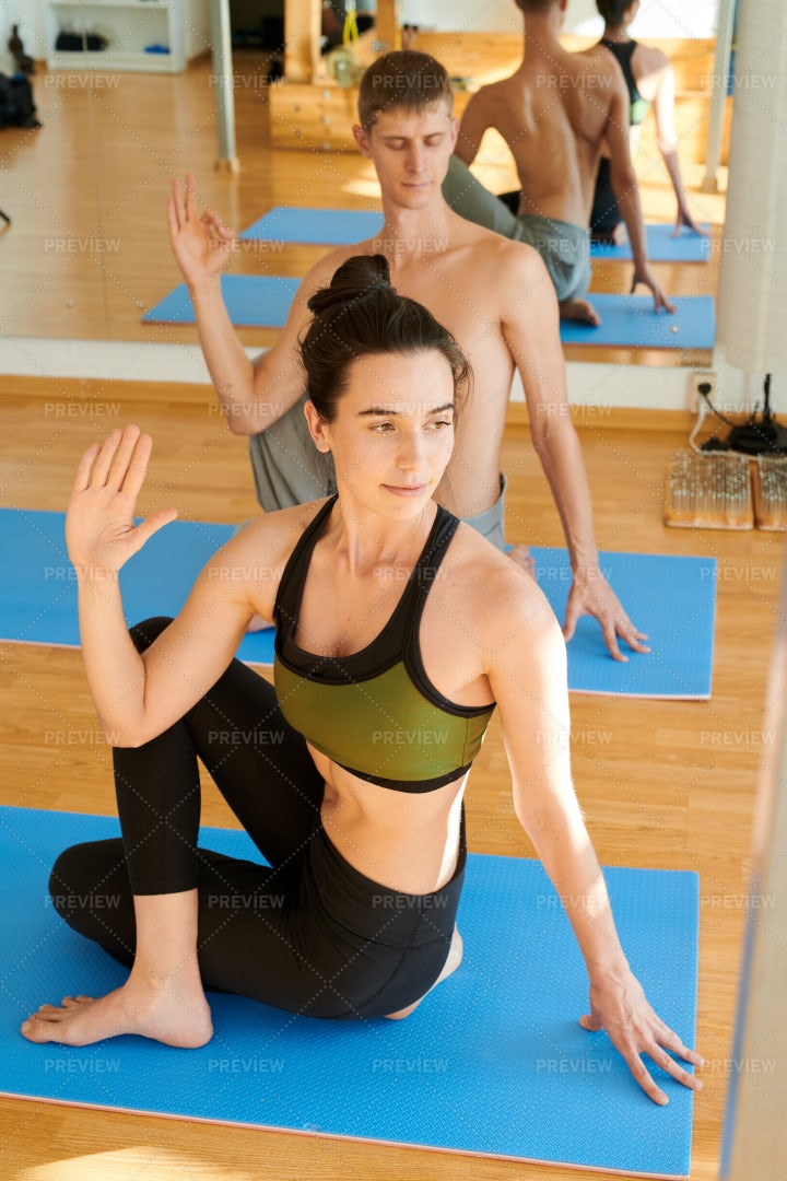 Twisting Backs At Yoga Practice: Stock Photos