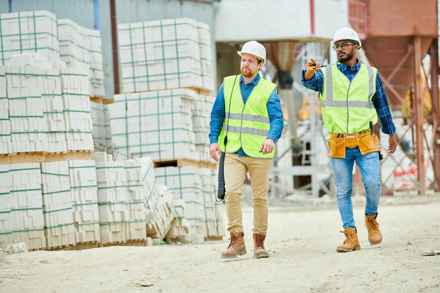 Building Inspectors Walking On...: Stock Photos