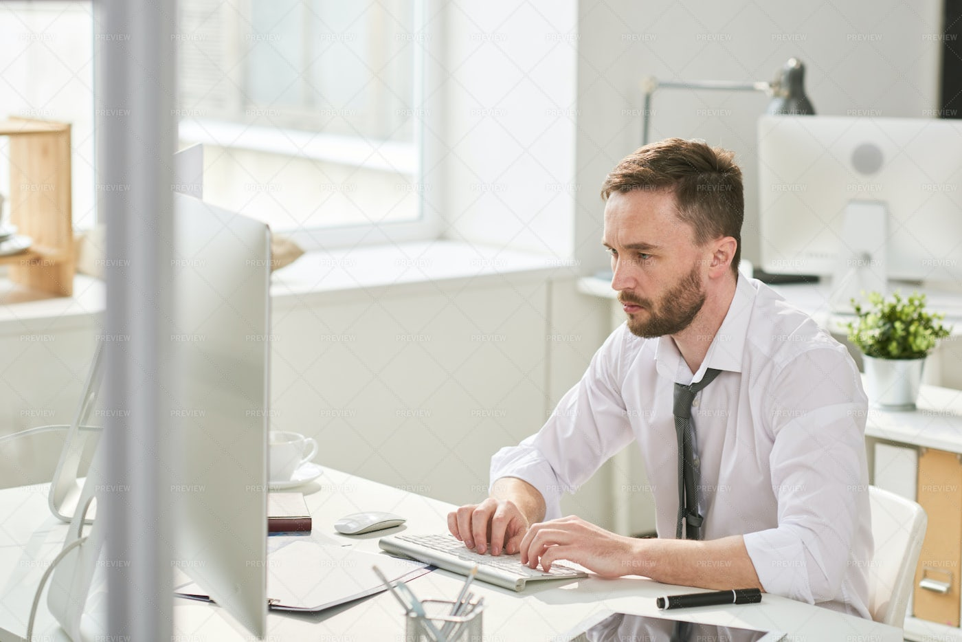 Busy Man Working Hard In Office: Stock Photos