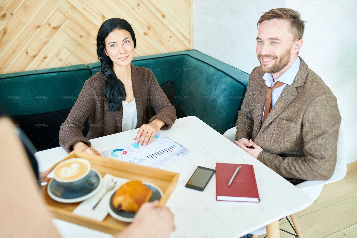 Business People Meeting In Cafe: Stock Photos