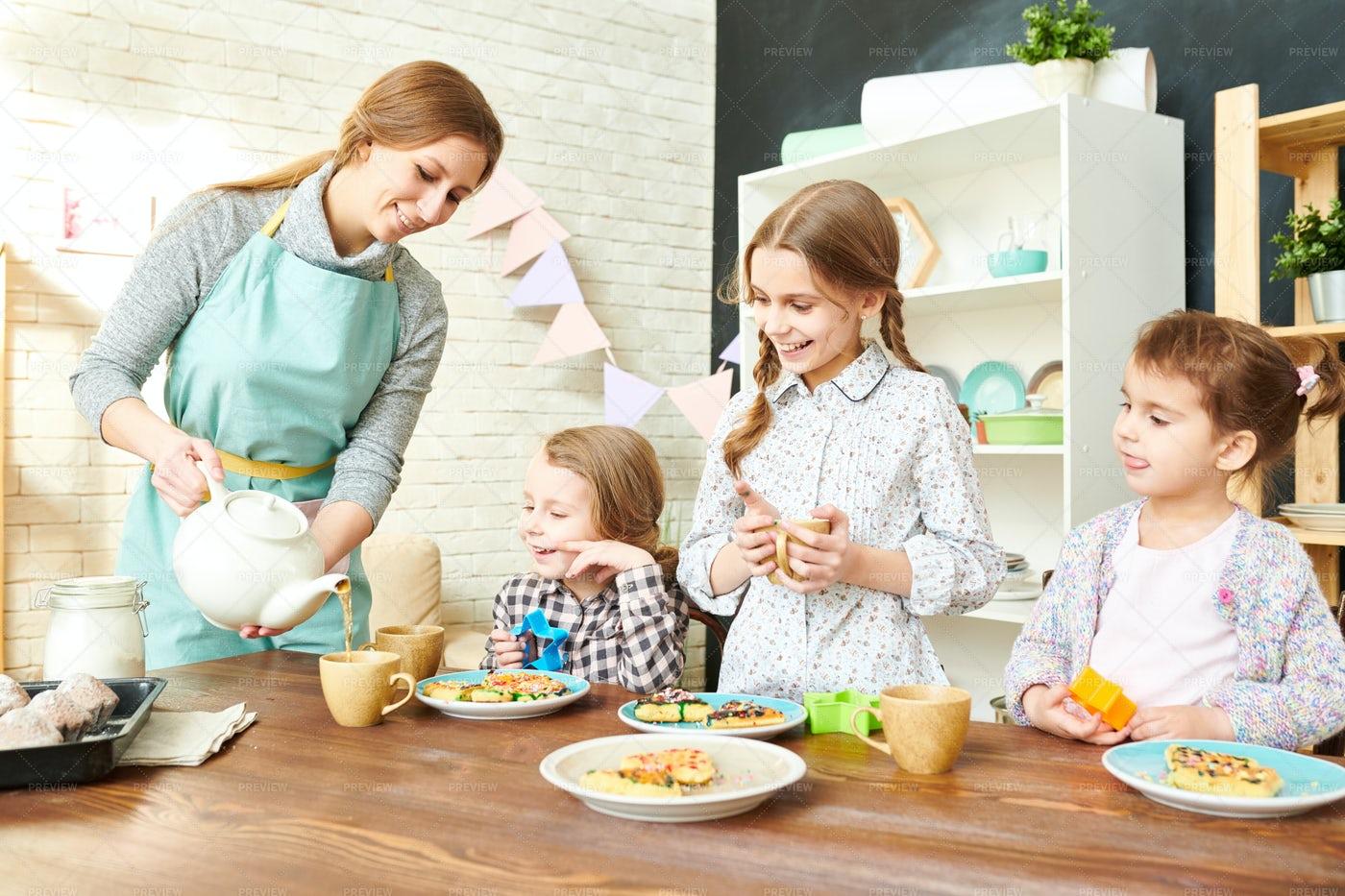 Adorable Family Having Tea Party: Stock Photos