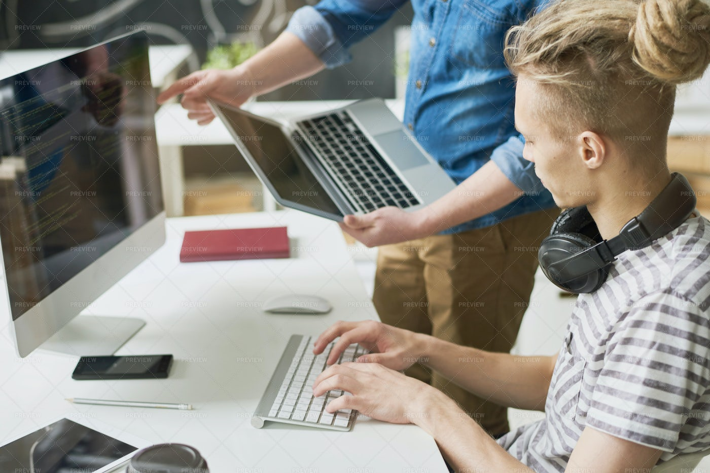 Colleagues Coding Information In...: Stock Photos