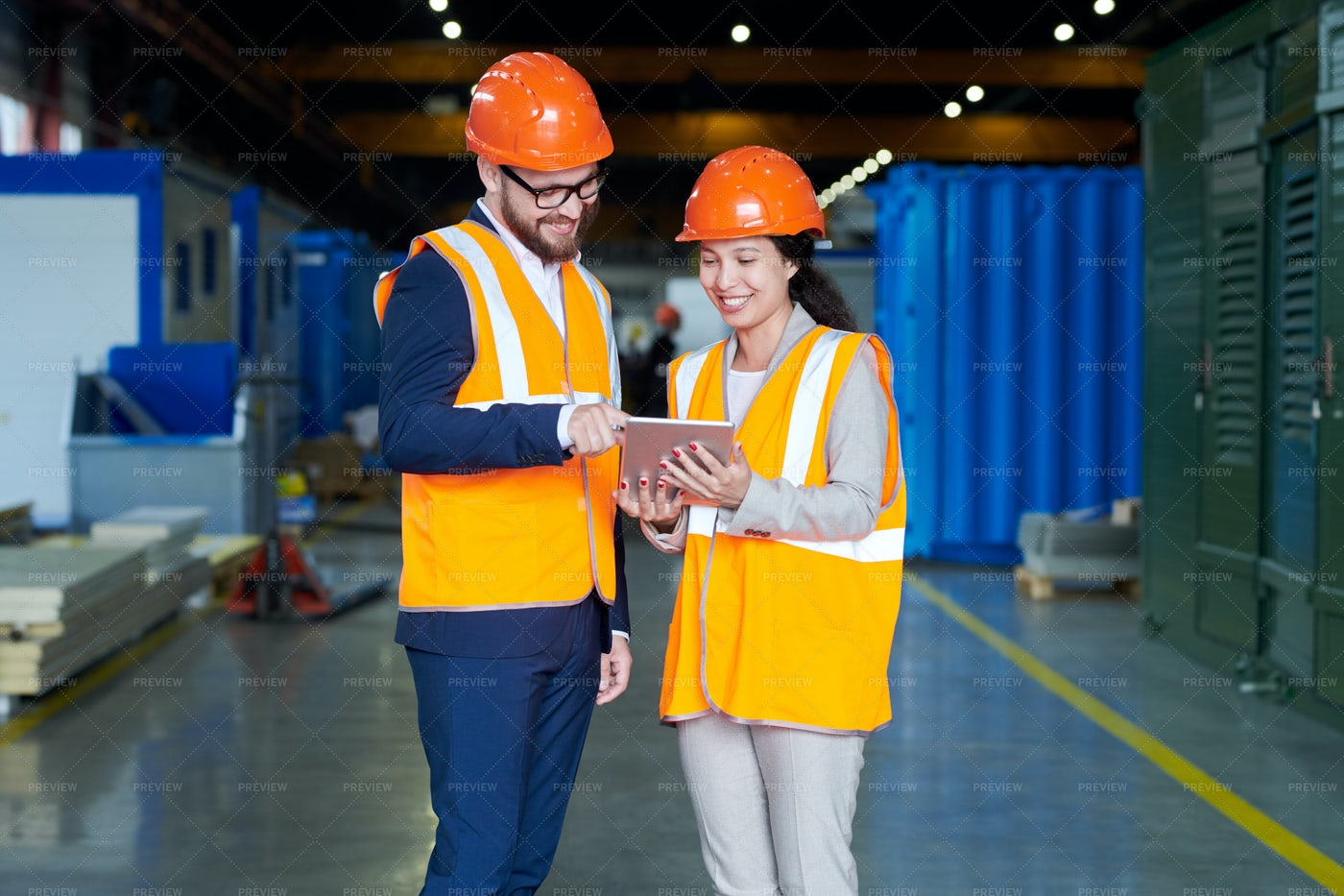 Female Factory Worker Talking To...: Stock Photos