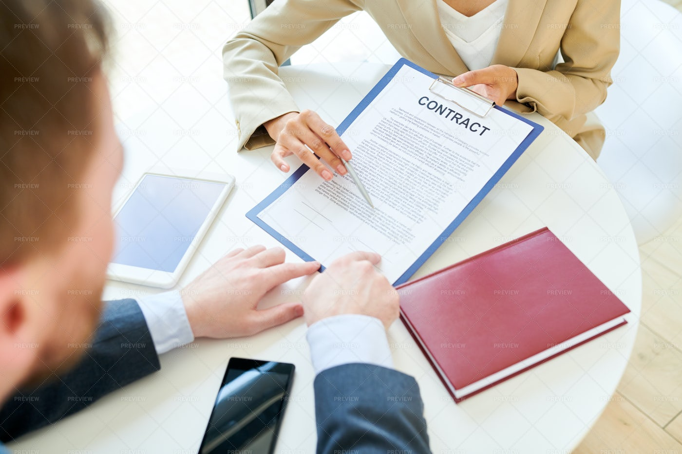 Businesswoman Showing Contract To...: Stock Photos