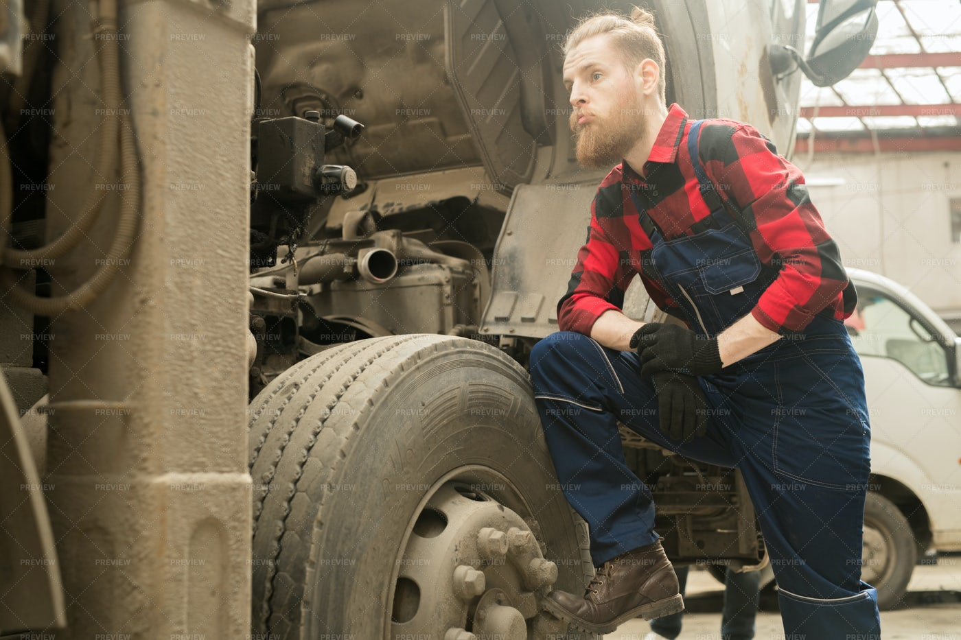 Mechanic Thinking About Truck...: Stock Photos