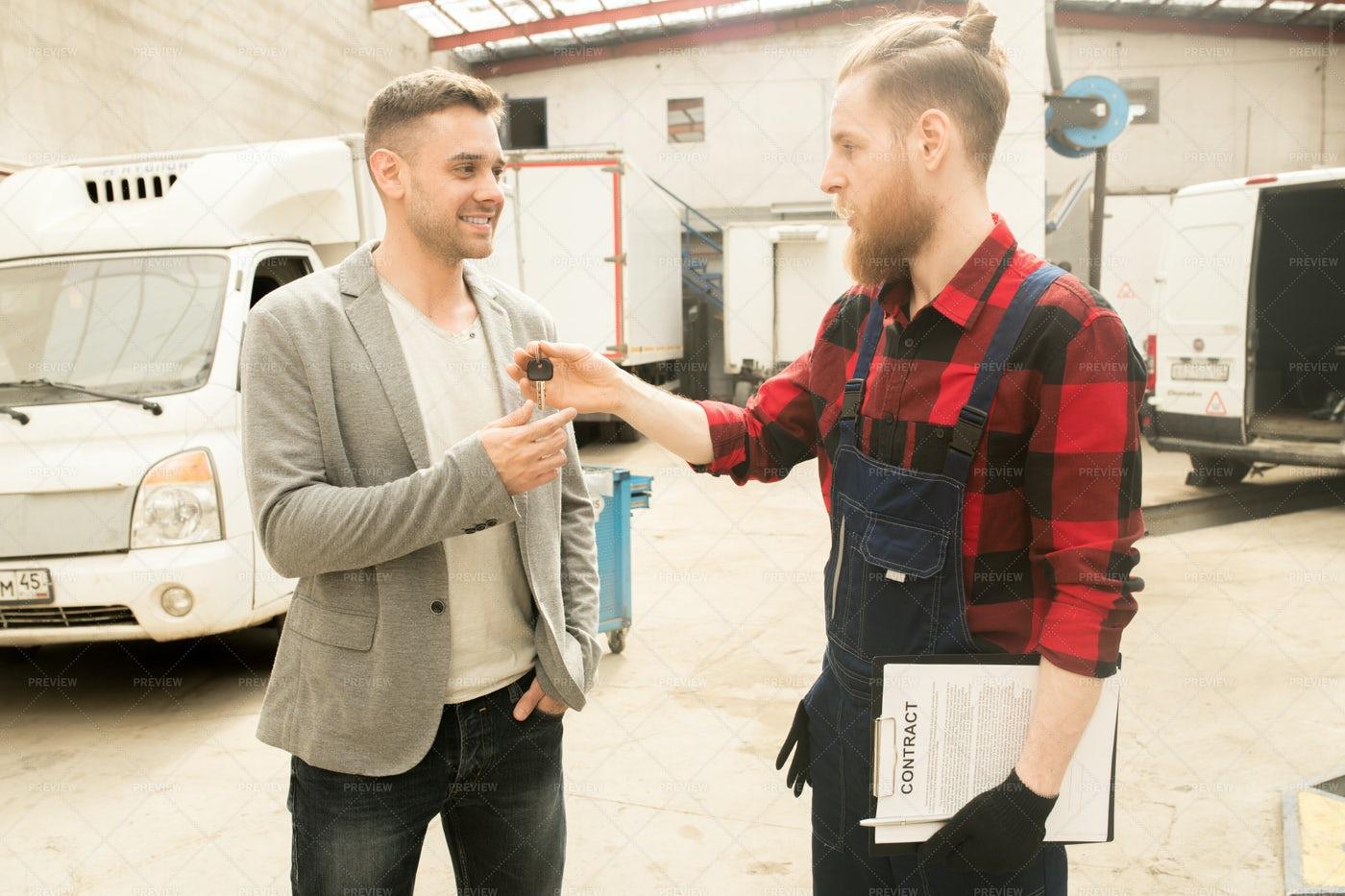 Repairman Giving Car Keys To...: Stock Photos