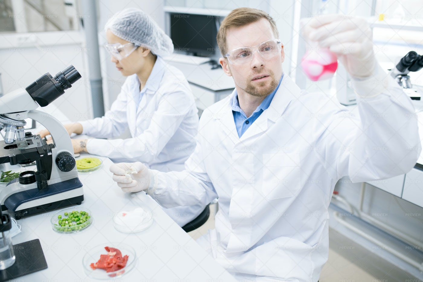Modern Scientists Doing Research In...: Stock Photos