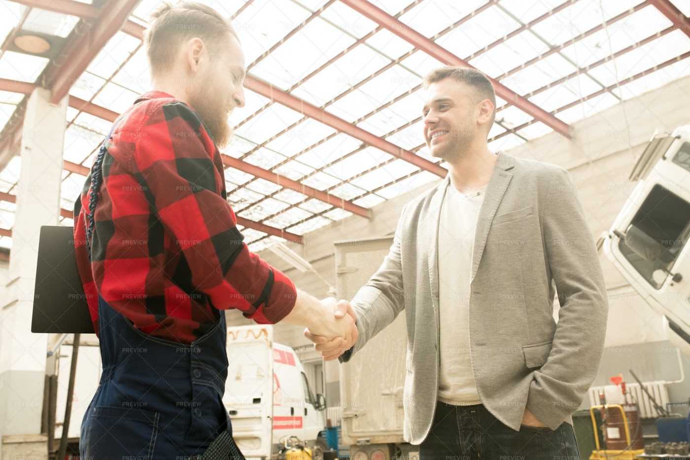 Repairman Shaking Hands With Client: Stock Photos