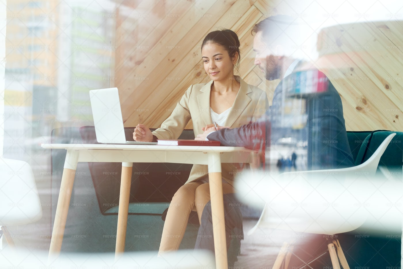 Young Businesswoman Working Behind...: Stock Photos