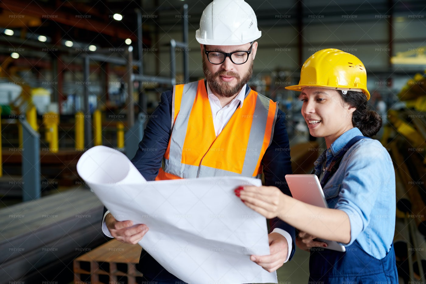Engineers Studying Plans: Stock Photos
