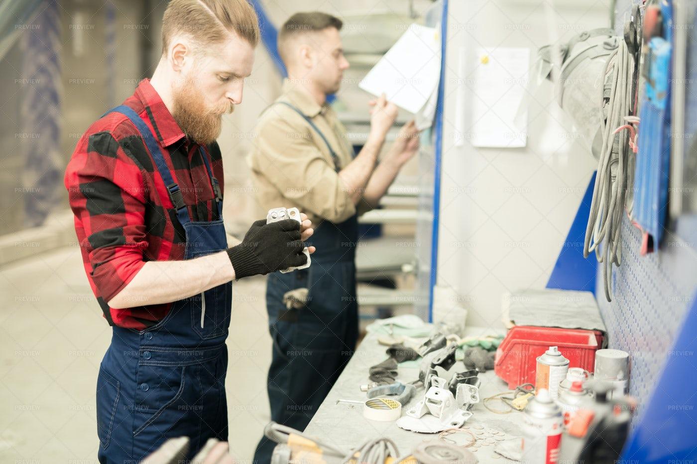 Mechanics Working In Repair Shop: Stock Photos