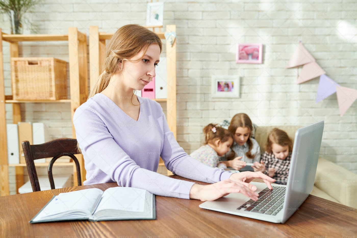 Young Mother Wrapped Up In Work: Stock Photos
