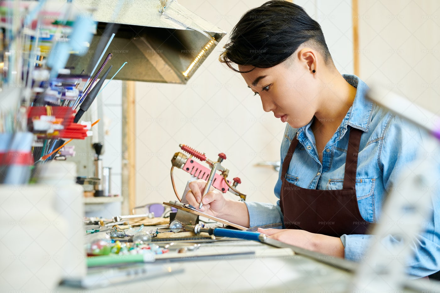 Asian Woman In Glassworking Studio: Stock Photos