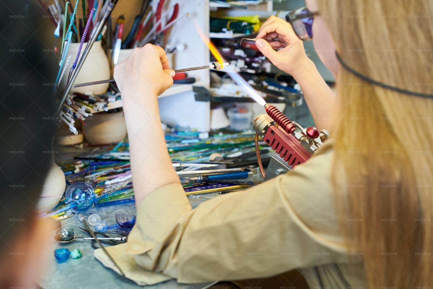 Female Artist Shaping Glass: Stock Photos