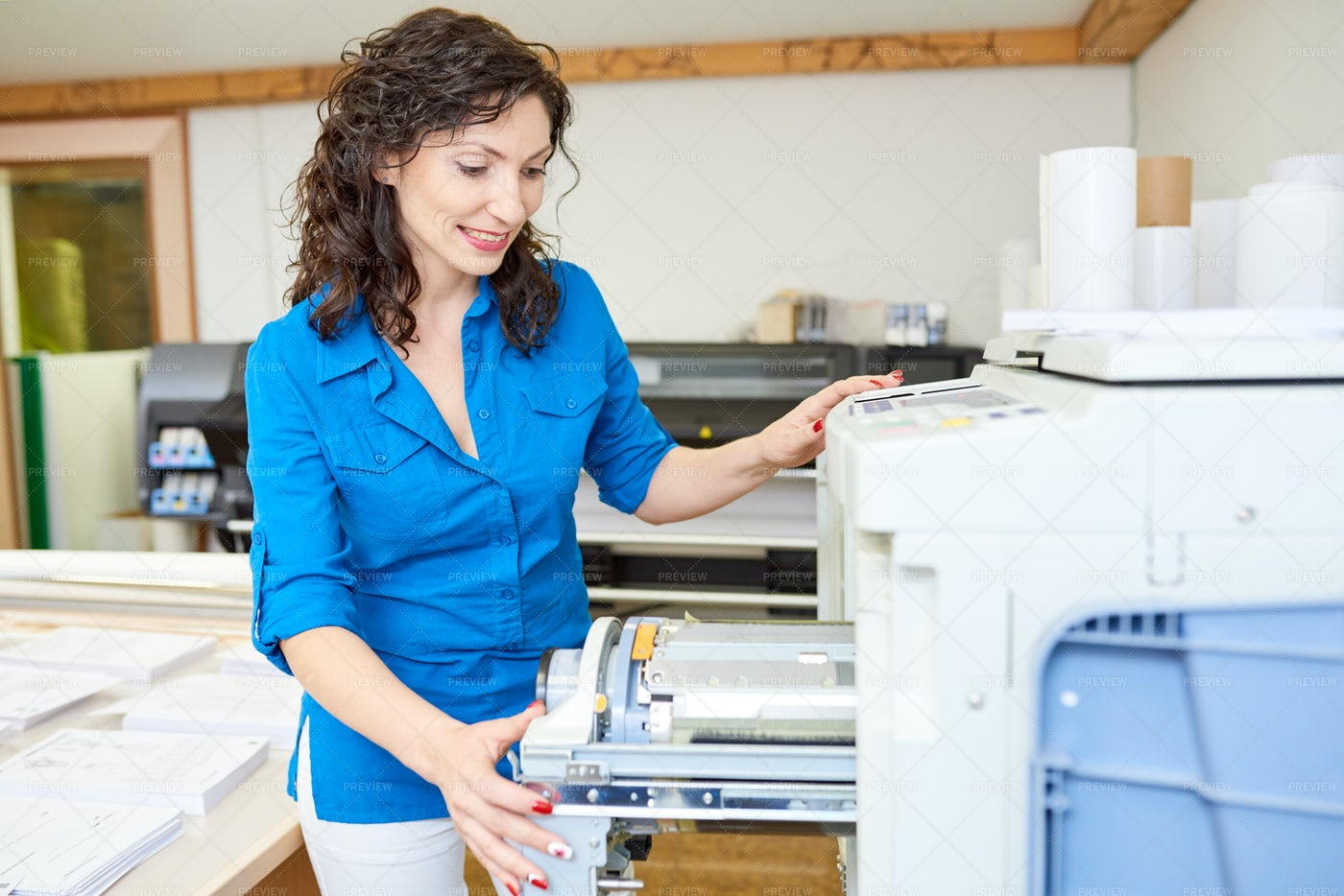 Adult Woman Checking Printer In...: Stock Photos