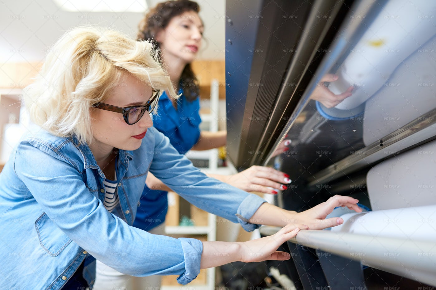 Two Women Working With Plotter: Stock Photos