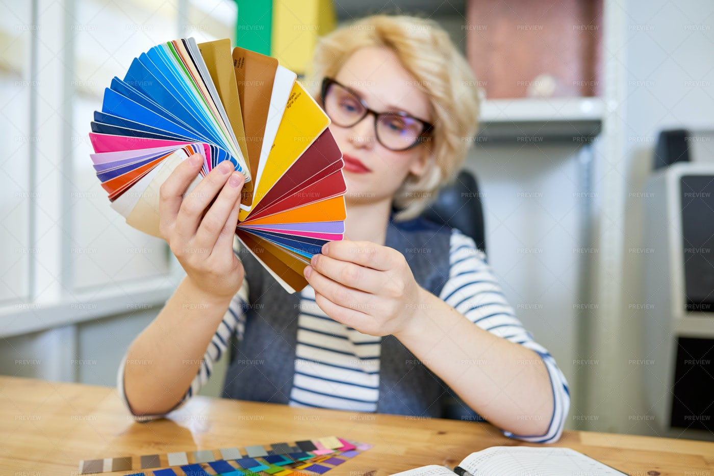 Designer Looking At Color Samples: Stock Photos