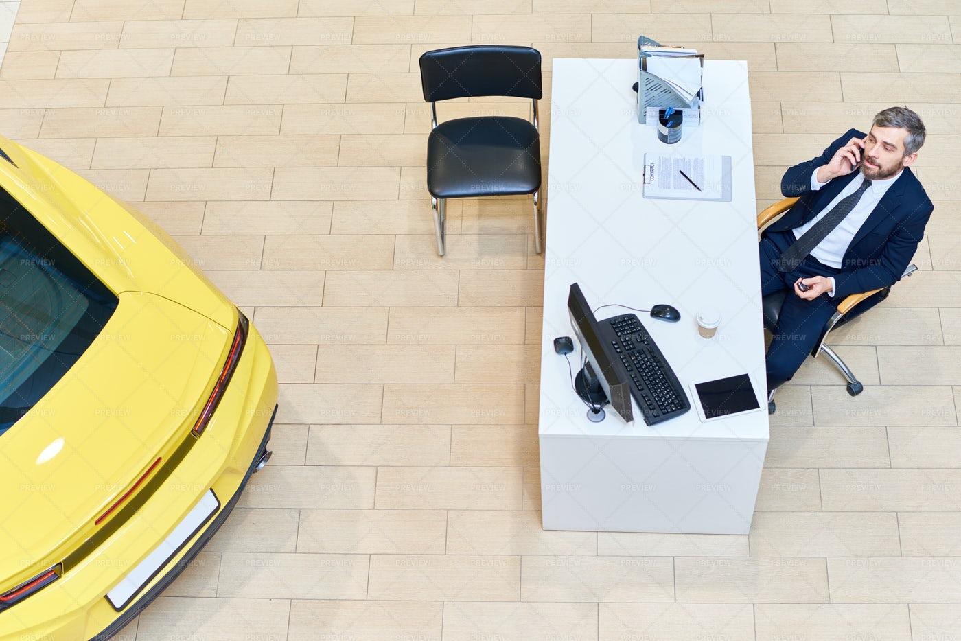 Car Salesman Speaking By Phone: Stock Photos