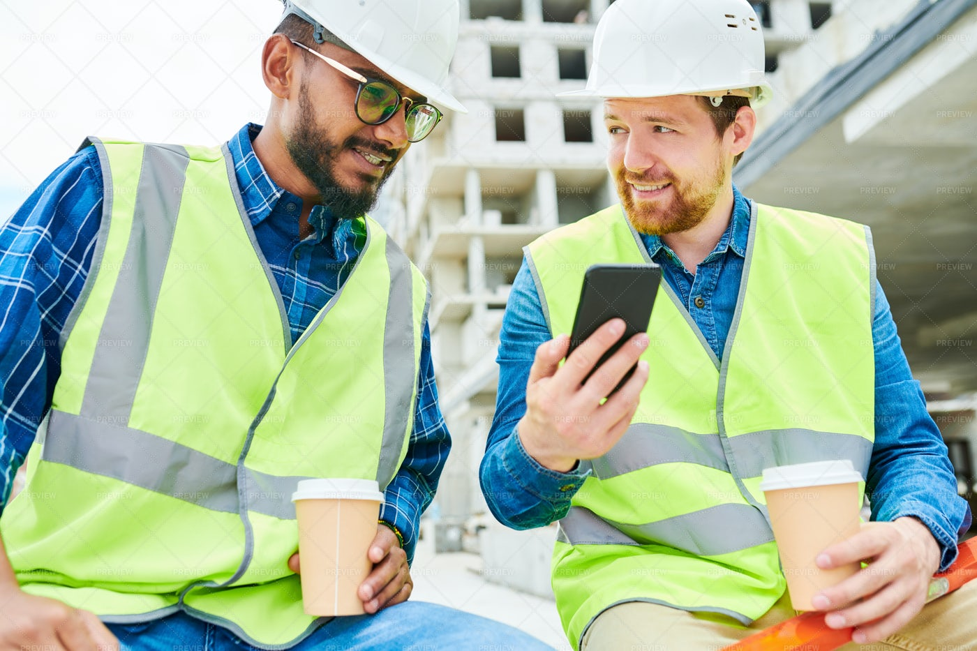 Engineer Showing Smartphone To...: Stock Photos