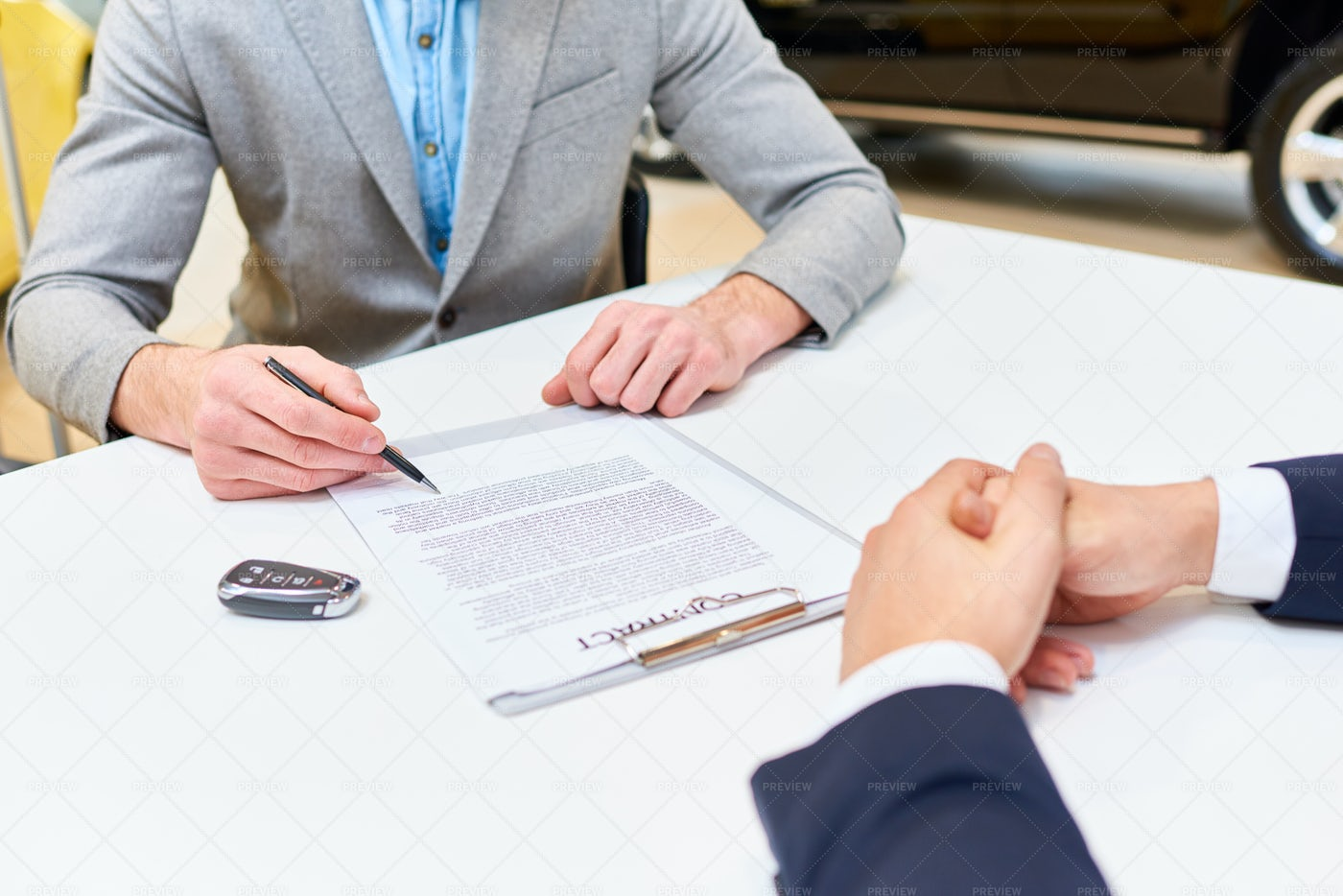 Man Signing Papers To Buy Car: Stock Photos