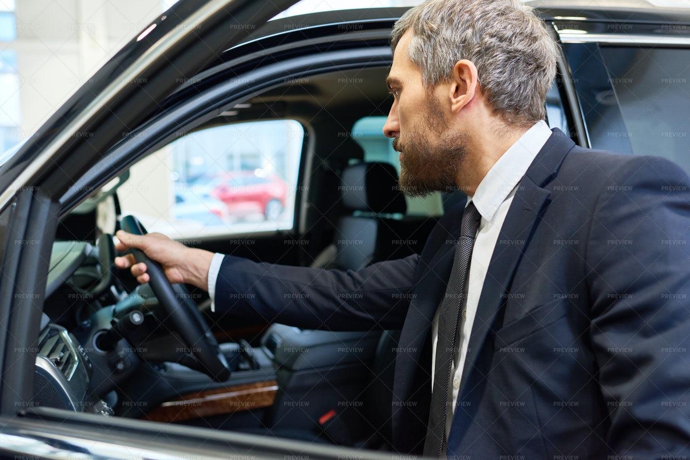 Mature Man Choosing Car For Rent: Stock Photos