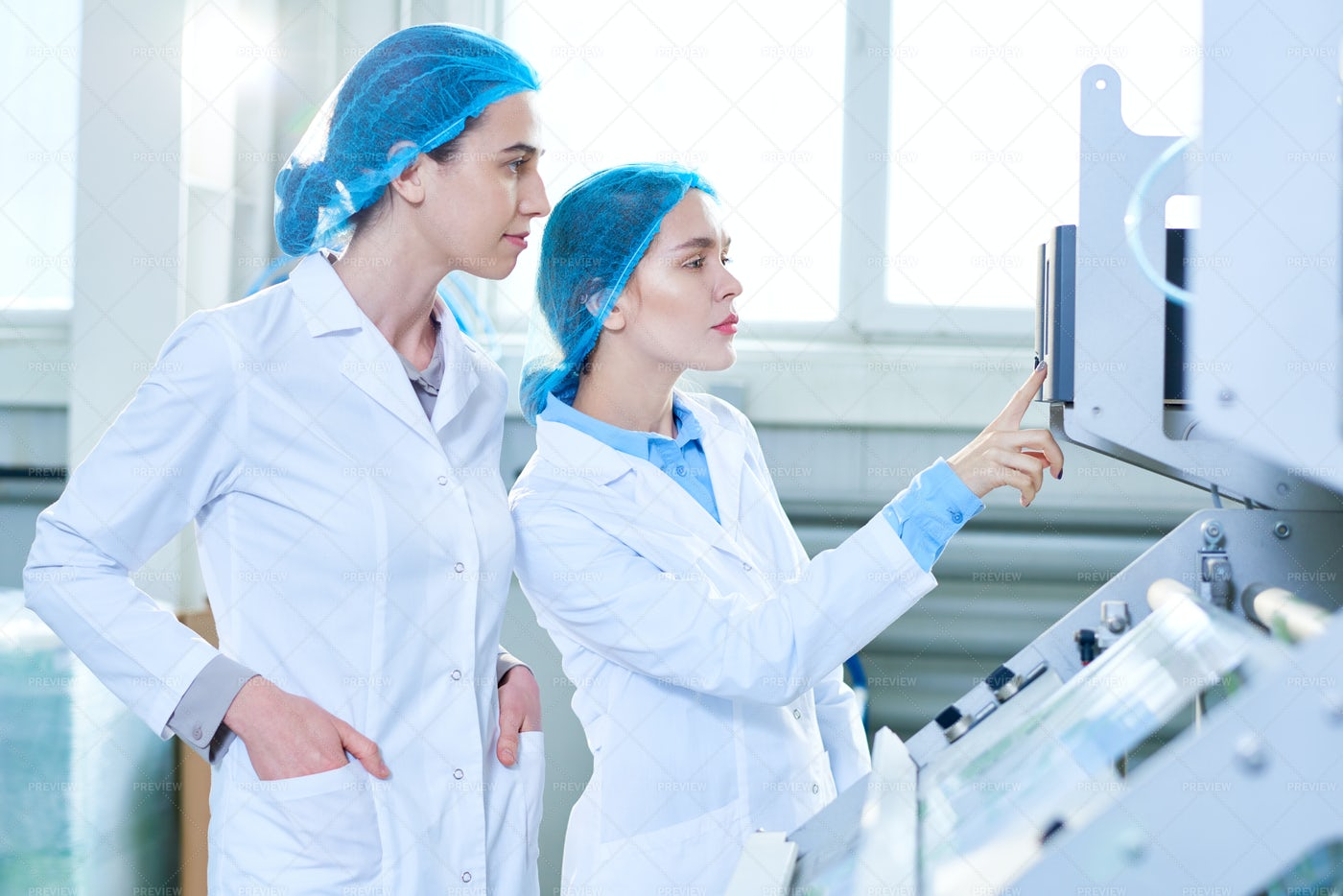 Two Female Specialists At Factory: Stock Photos