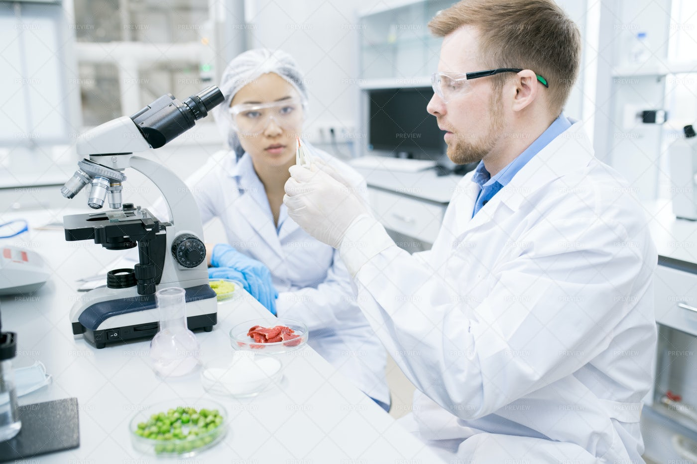 Woman Scientist Looking At...: Stock Photos