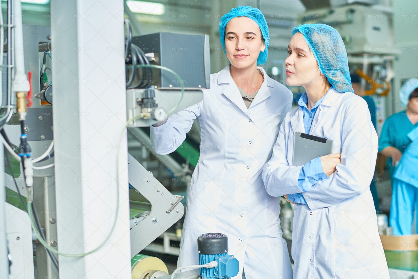 Female Workers At Factory: Stock Photos