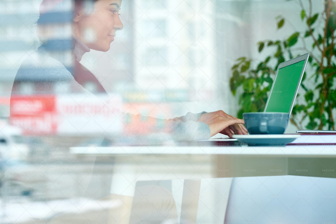 Pretty Woman Working Behind Glass...: Stock Photos