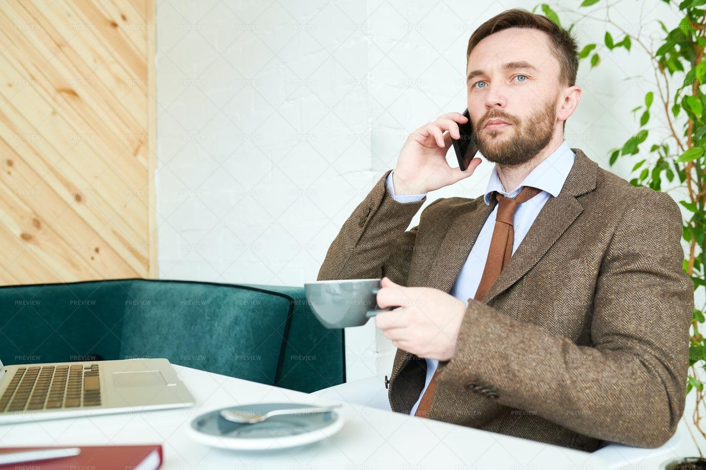 Successful Businessman In Cafe: Stock Photos