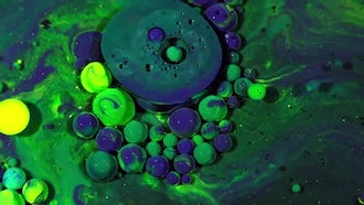 Colorful Ink Spheres On Oil 31: Stock Video