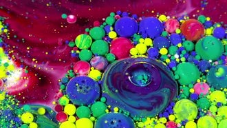 Colorful Ink Spheres On Oil 34: Stock Video
