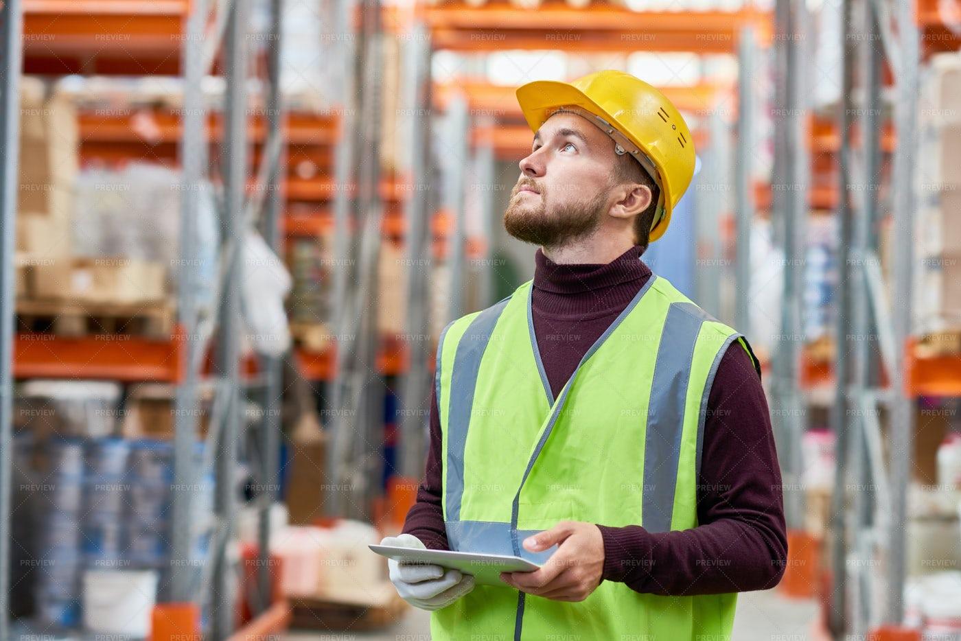 Warehouse Worker Using Digital...: Stock Photos