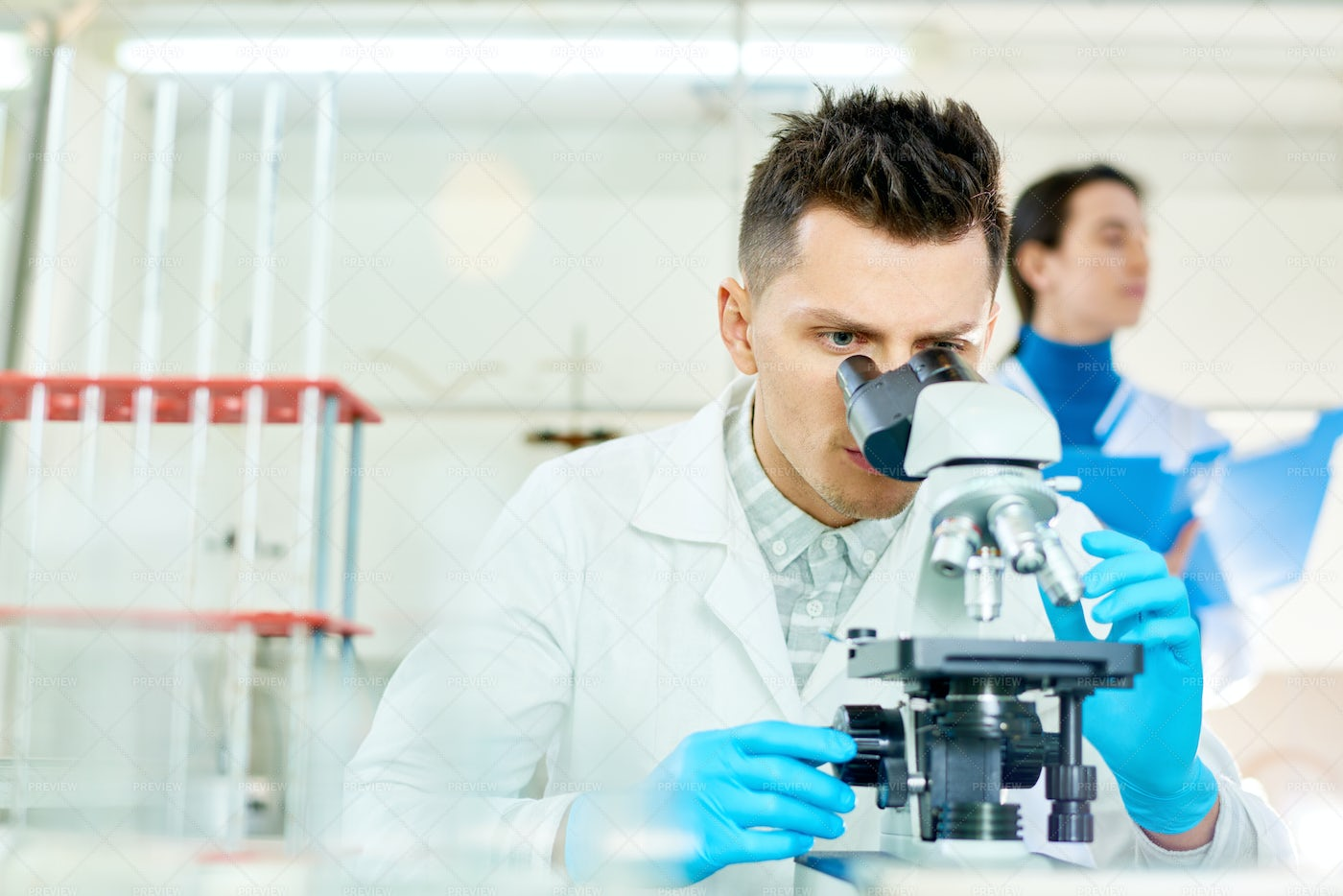 Young Scientist Using Microscope: Stock Photos