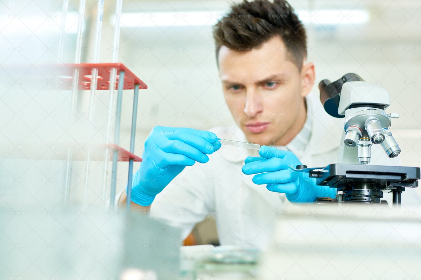 Concentrated Researcher Wrapped Up...: Stock Photos