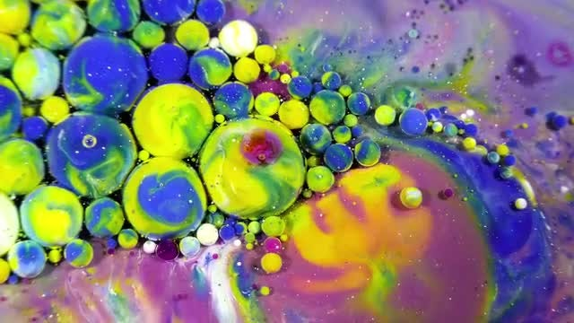 Colorful Ink Spheres On Oil 43: Stock Video