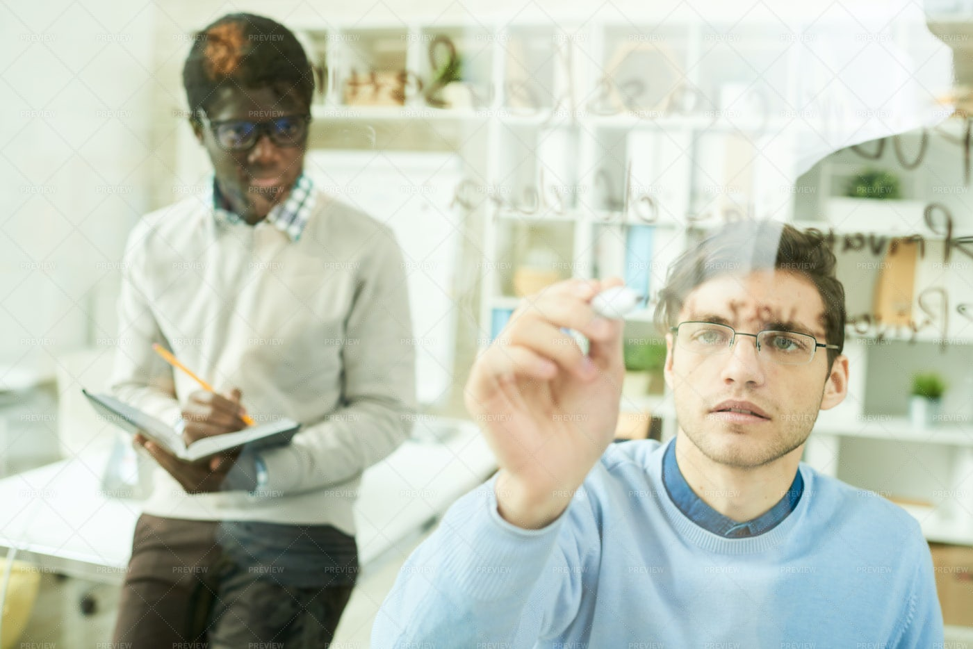 IT Developers Writing On Glass Wall: Stock Photos
